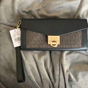 NWT Michael Kota large Viola leather wallet